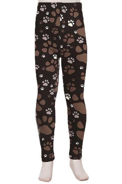 Front of Creamy Soft Muddy Paw Print Kids Leggings - USA Fashion™ with a cute neutral design on a black background.