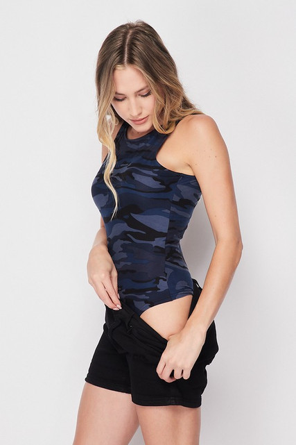Right side view of Brushed Navy Camouflage Mock Neck Bodysuit pictured with shorts pulled down to show off the bottom half of the one piece.