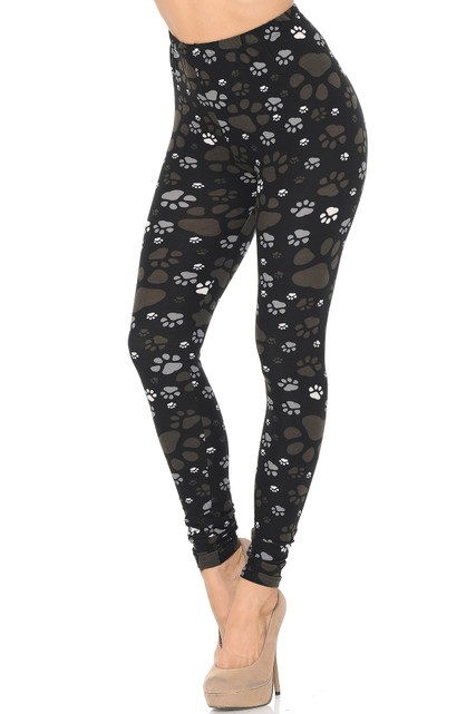 45 degree image of Creamy Soft Muddy Paw Print Leggings - USA Fashion™ with an easy to style brown, gray, and white design.