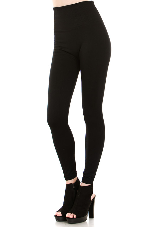 9d4e472a1c58c1 45 degree image of our Black Banded High Waisted Fleece Lined Leggings  showing the ribbed high