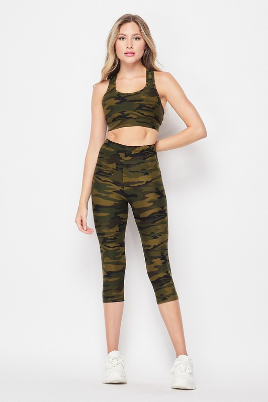 Front on view of 2 Piece Green Camouflage Crop Top and Capris Set shown paired with simple white sneakers.
