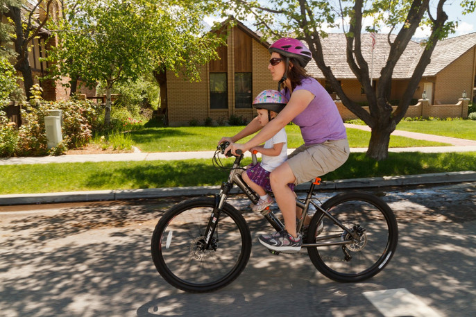 """5' 4"""" mom with 3 1/2 year old daughter on mountain style bicycle."""