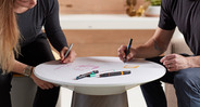 Write ideas on the sturdy glass top with standard dry erase markers