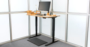 "48"" x 30"" natural rubberwood desktop on a black UPLIFT V2 Standing Desk Frame"