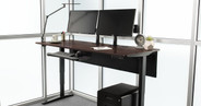"72"" x 30"" dark brown rubberwood desktop on a black UPLIFT V2 Standing Desk Frame"