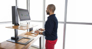 The E7 Electric Standing Desk Converter by UPLIFT Desk comes with a tiered keyboard tray that keeps you comfy at your keyboard