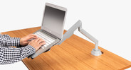To elevate your laptop, choose the UPLIFT Laptop Mount to add to your arm