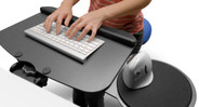 An ergonomic keyboard tray helps allows you to type with your wrists straight, which reduces everyday strain
