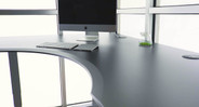Spacious desktop surface features an inside corner cut-out ergo edge and a smooth finish