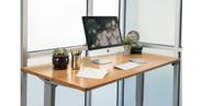 "Gray UPLIFT V2 Standing Desk Frame with our 60"" x 30"" carbonized bamboo desktop"