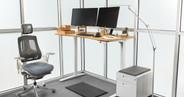 "White UPLIFT V2 Standing Desk Frame with our 60"" x 30"" carbonized bamboo desktop"