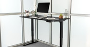 """60"""" x 30"""" black GREENGUARD-certified laminate desk on a black UPLIFT V2 Standing Desk Frame"""