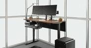 """60"""" x 30"""" walnut GREENGUARD-certified laminate desk on a Black UPLIFT V2 Standing Desk Frame"""