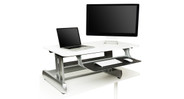 """The Life Fitness InMovement Elevate Desktop DT2 Standing Desk's large 41"""" surface area supports a full standing workstation with dual monitors"""