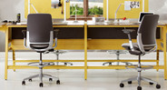 Standard armrests are fully adjustable on the Steelcase Amia Drafting Chair