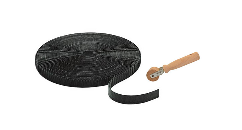 Individual strips of Velcro® can be applied to the underside of a vinyl backed mat to keep mat to attach it to looped pile carpeting