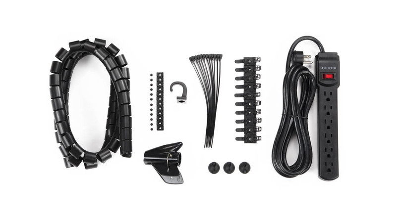 Basic Wire Management Kit with 12 screw-in cable mounts, 12 reusable cable ties, 10 readjustable cable tie mounts, 3 cable management clips, basic surge protector, cable organizer, accessory hook, and hardware