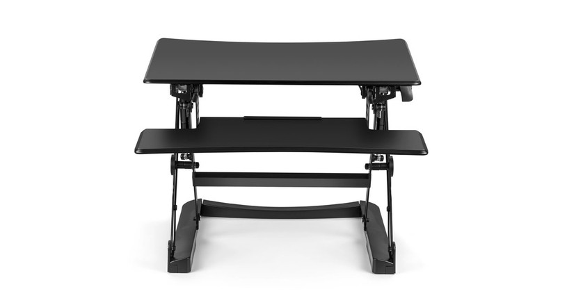 The Lift Standing Desk Converter by UPLIFT Desk converts fixed-height spaces into height-adjustable workstations