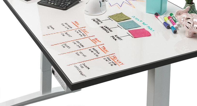 Enjoy a height adjustable desk that takes your creativity to new heights with the Whiteboard Sit-Stand Desk by UPLIFT Desk
