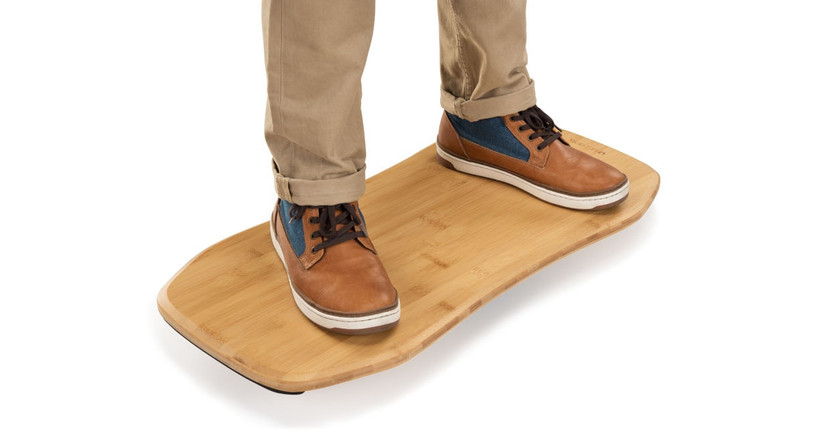 Rock, tilt, swivel, and move more throughout the day on the Bamboo Motion-X Board by UPLIFT Desk