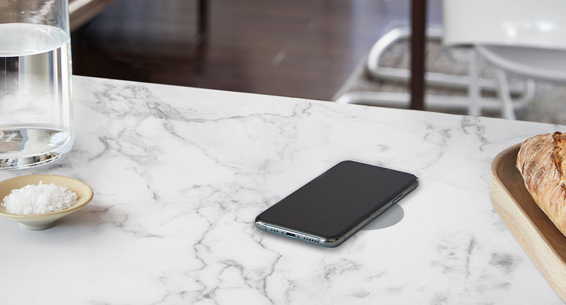Wirelessly charge your devices from your table with the Humanscale NeatCharge