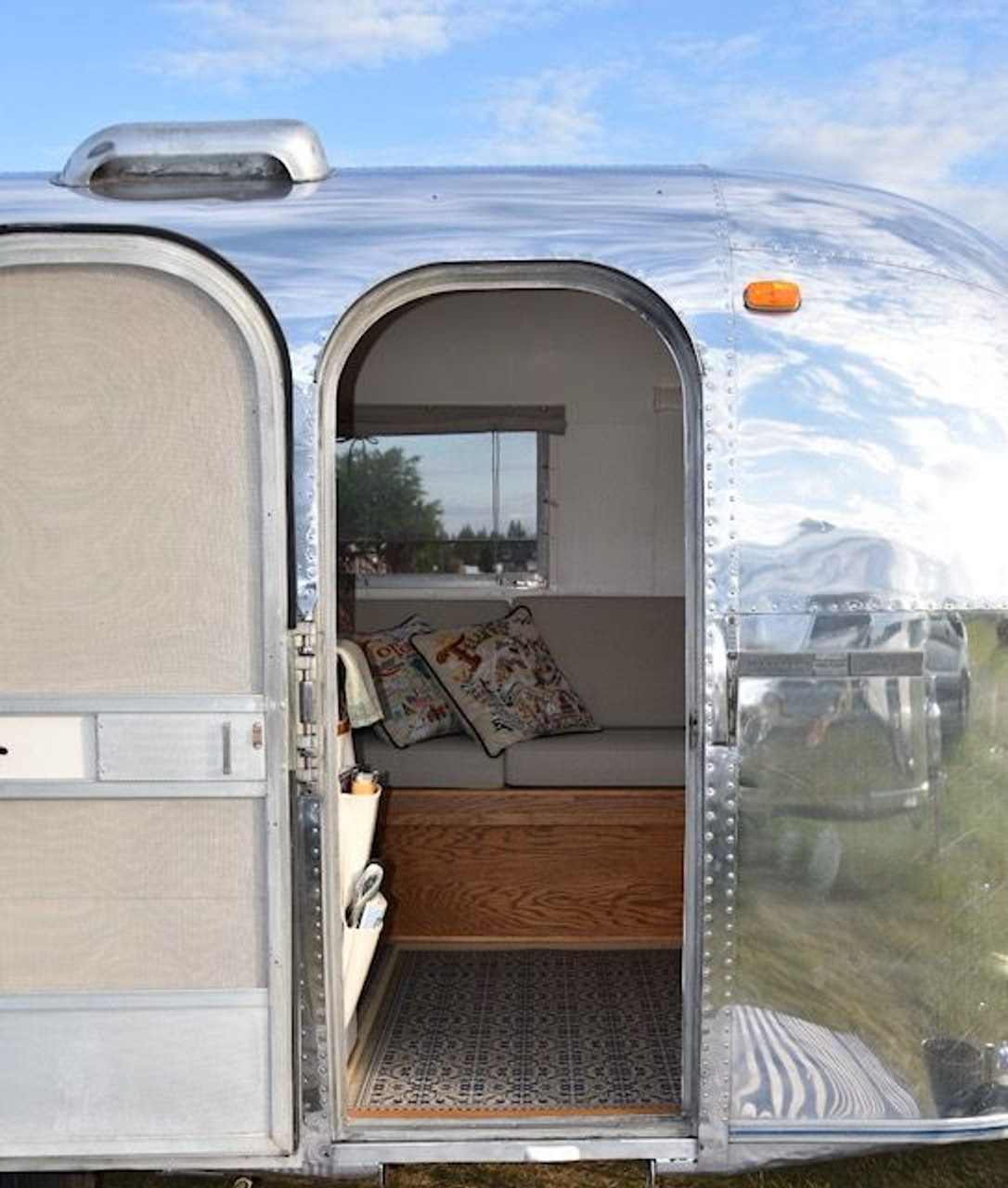 Pura Vida customer use of Mad Hatter Tea Party vinyl floor cloth in and Airstream!