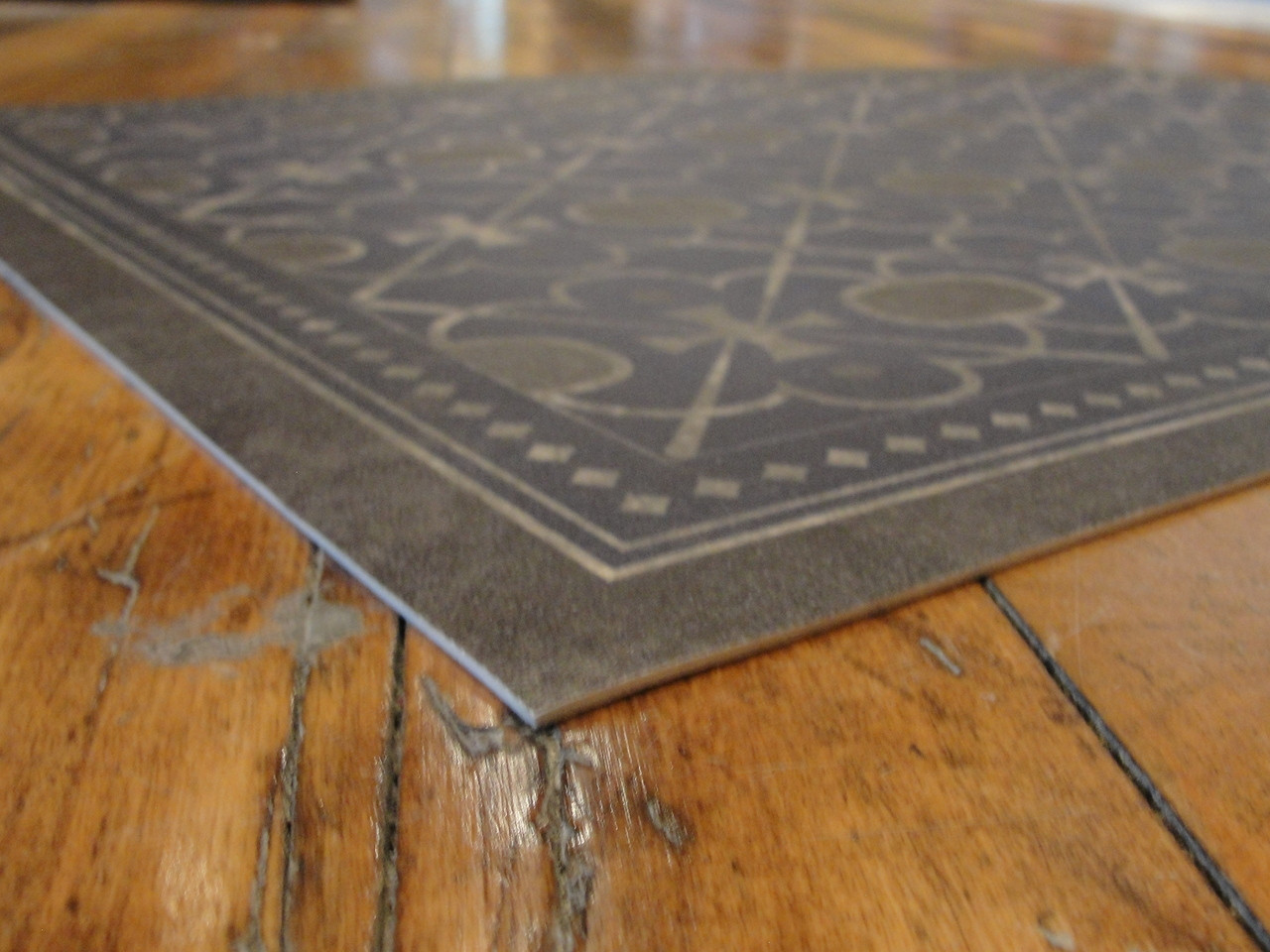 """Only 1/8"""" thick, lays flat, edges will not curl, thickness of a quarter."""