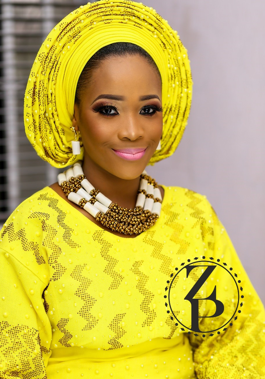 yoruba-woman-in-nigerian-yellow-iro-and-buba-white-coral-beads.jpg