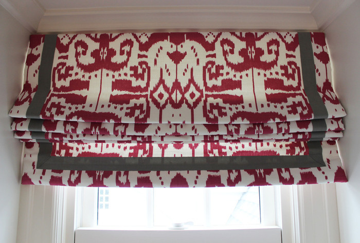 Custom Roman Shade by Lynn Chalk in Quadrille China Seas Island Ikat in Magenta with Samuel & Sons Grosgrain Ribbon Trim in Steel
