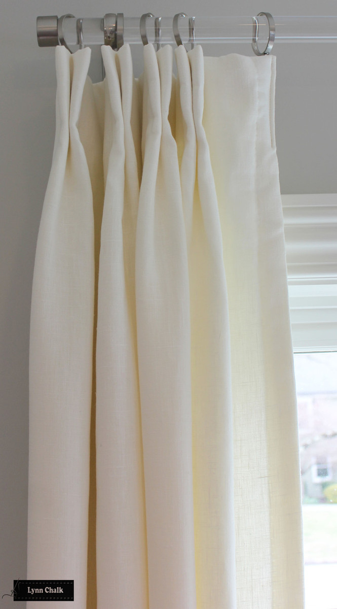 Drapes in Kravet Linen in Bleach.  Acrylic Rods by Ballard Design.