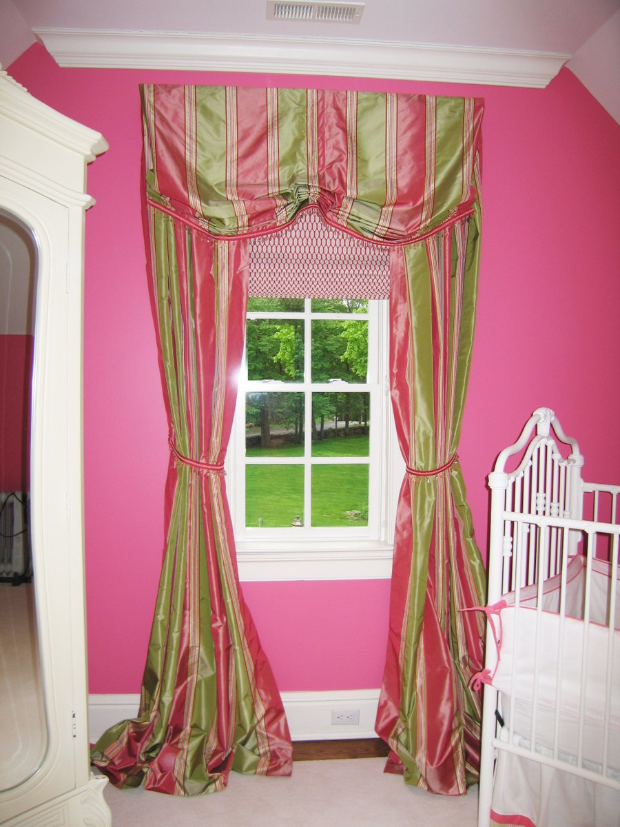 I designed and made this silk valance and matching drapes with roman shade for a nursery.  It appeared in At Home Magazine.