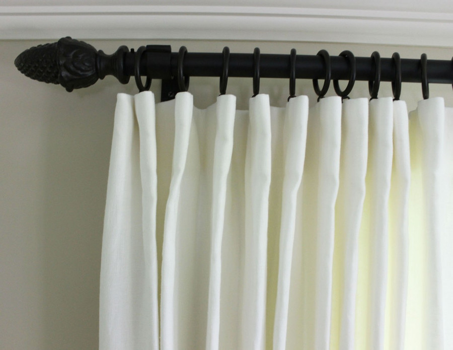 Close up of Cartridge Pleated Drapes in Kravet Dublin in Bleach.