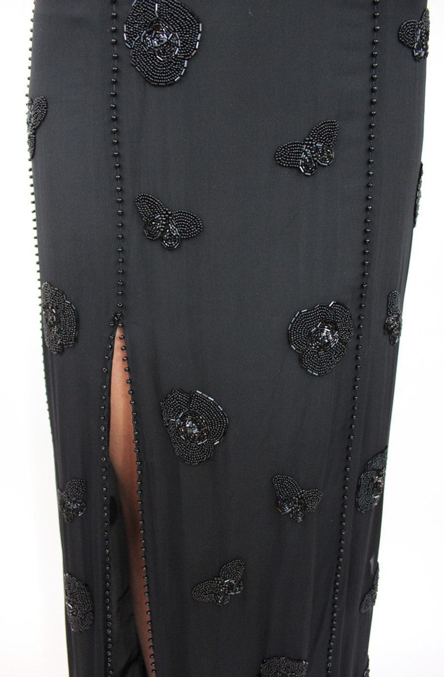 Closeup of front of dress with slit edged in beads