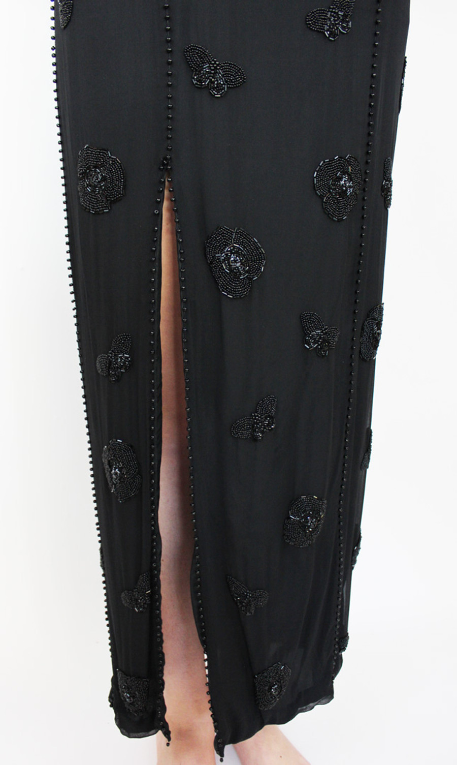 Front of dress with slit edged in beads