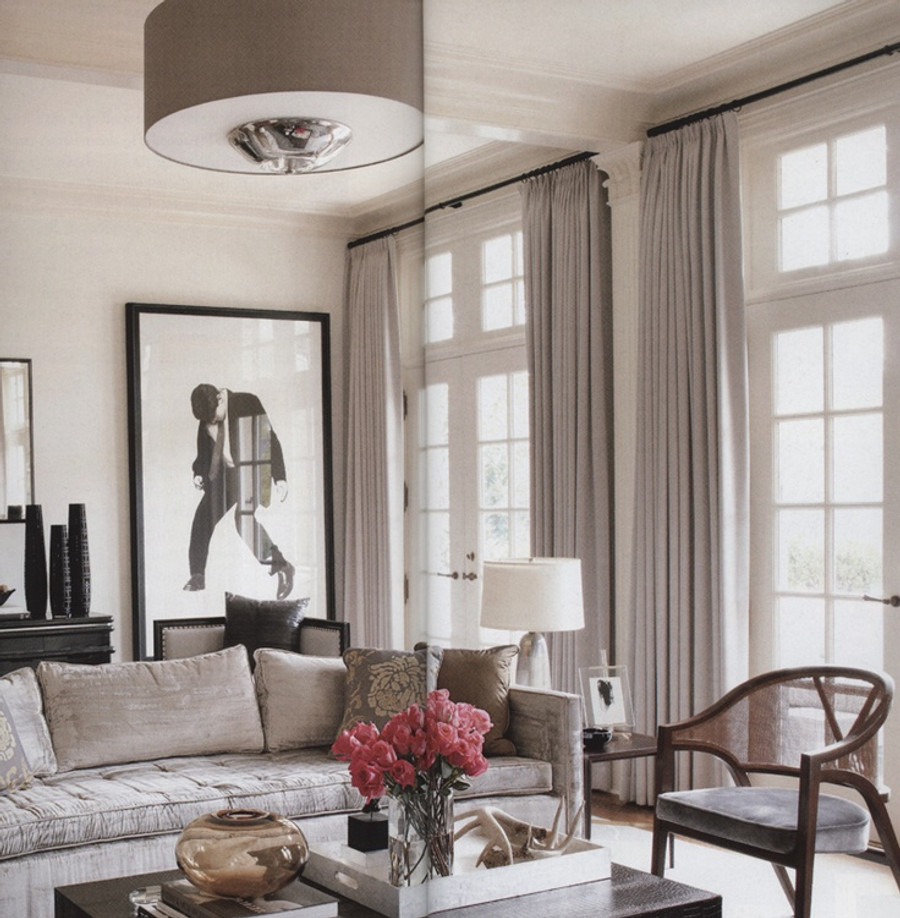 These beautiful drapes were featured in Architectural Digest.  Similar drapes can be made in Robert Allen Milan Solid Linen in Sterling or Zinc, or for a heavier weight linen, Robert Allen Heirloom Linen.