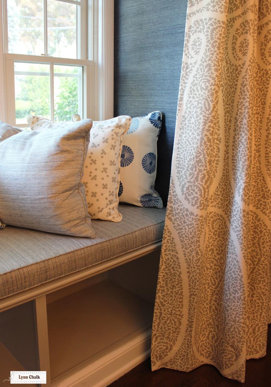 Schumacher Ambala Paisley Fog Drapes. Cushion in Schumacher Travertine Linen Weave in Denim.  Pillows in Groundworks Kasa and Christopher Farr Pollen. (Erika Mercurio Design)