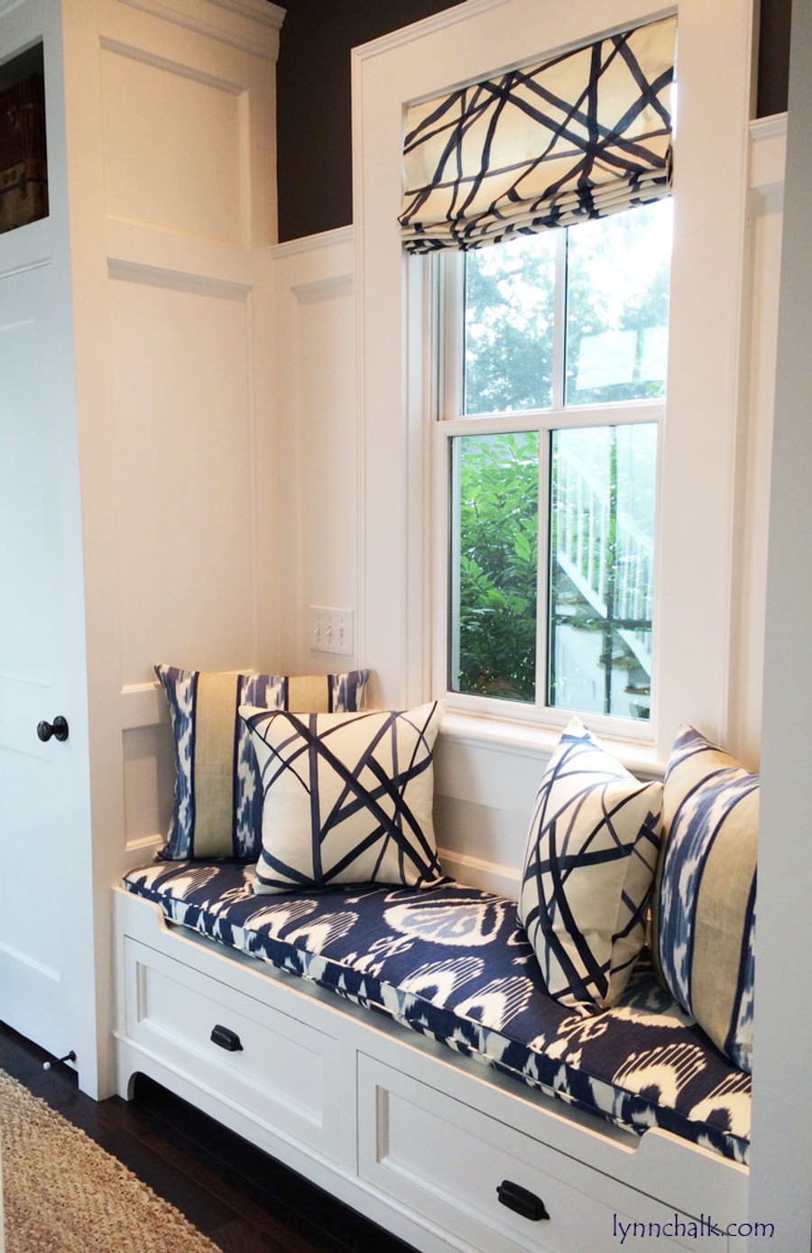 Custom Roman Shade and Pillows by Lynn Chalk in Kelly Wearstler Channels in Periwinkle.  Cushion is in Bansuri in Iris and back pillows are in Ranjani from Kravet.