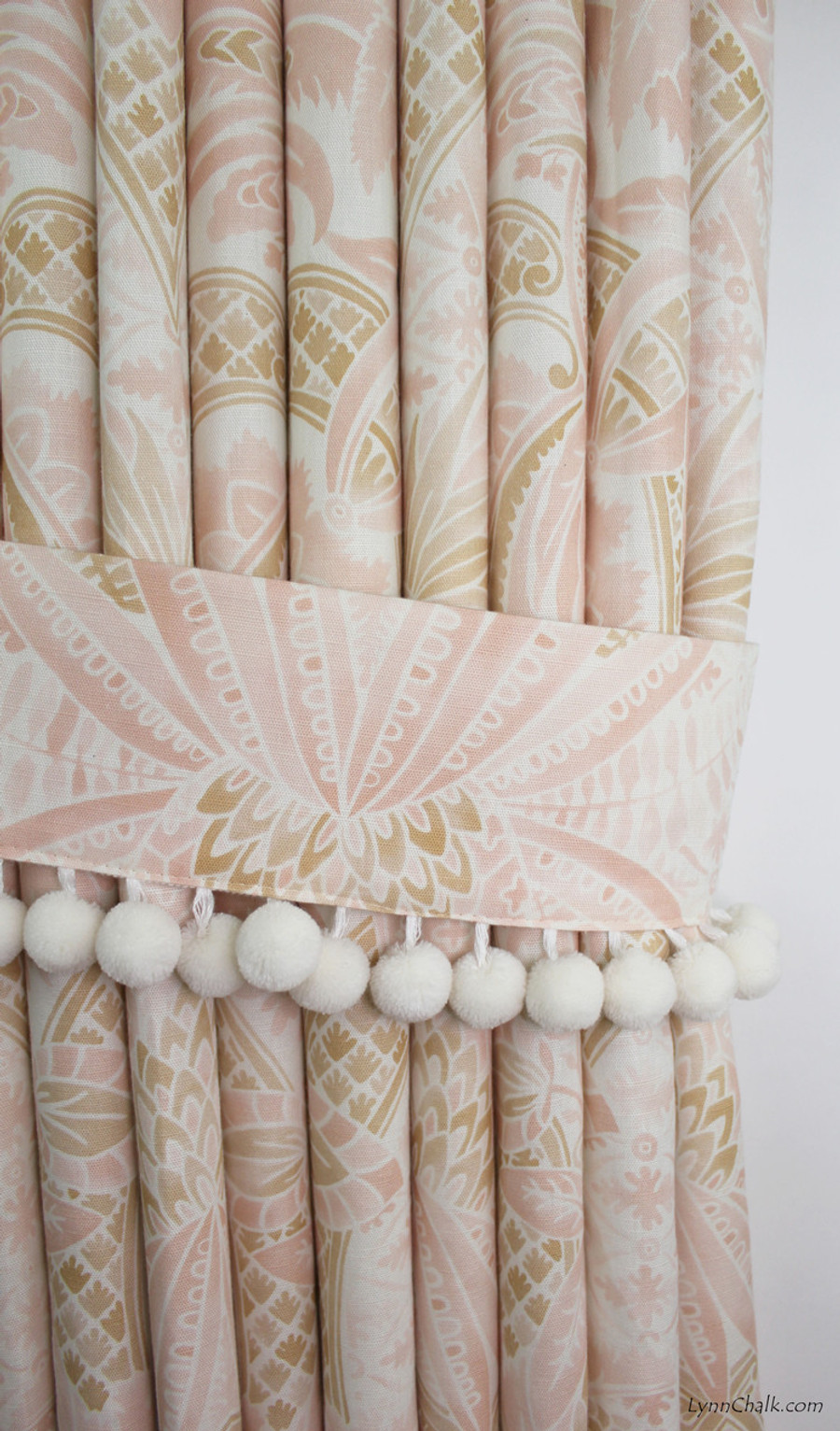 Custom Drapes in Cap Ferrat Blush with Tie Back.  Pom Pom Trim by Samuel and Sons in Whipped Cream