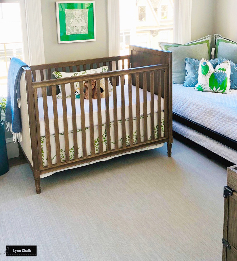 Schumacher Jungle Jubilee Leaf Green Crib Skirt and Pillow and Christopher Farr Carnival Pillow In Nursery