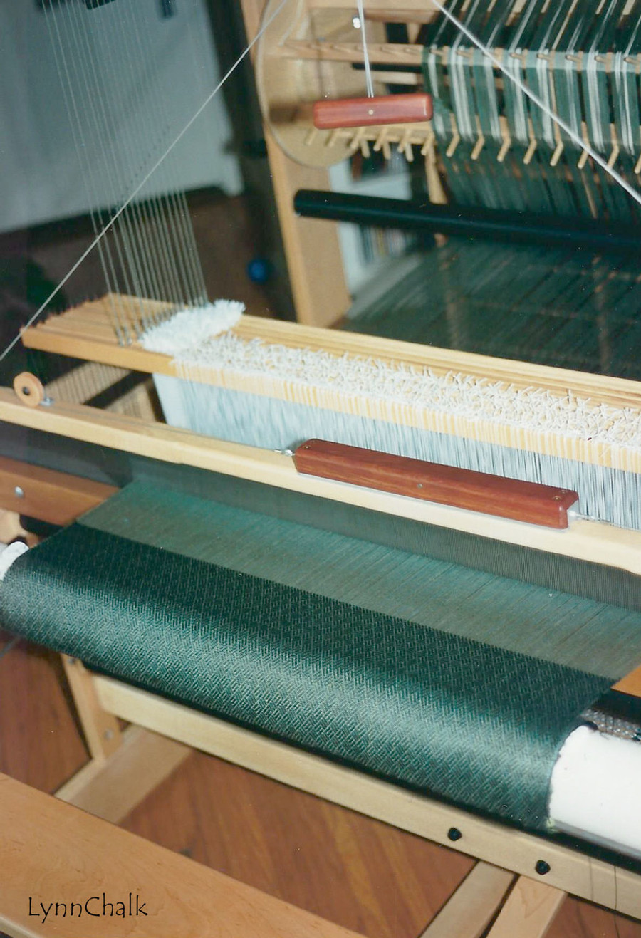 AVL Compu-Dobby Loom with Fabric being woven