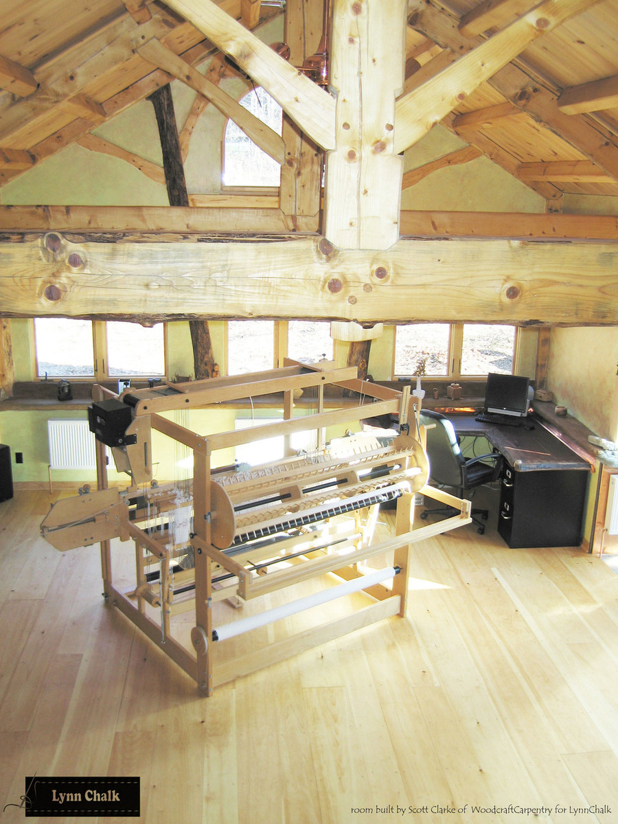 My studio with AVL Compu-Dobby Handweaving Loom.  My husband built my studio from the trees that grew on our property.