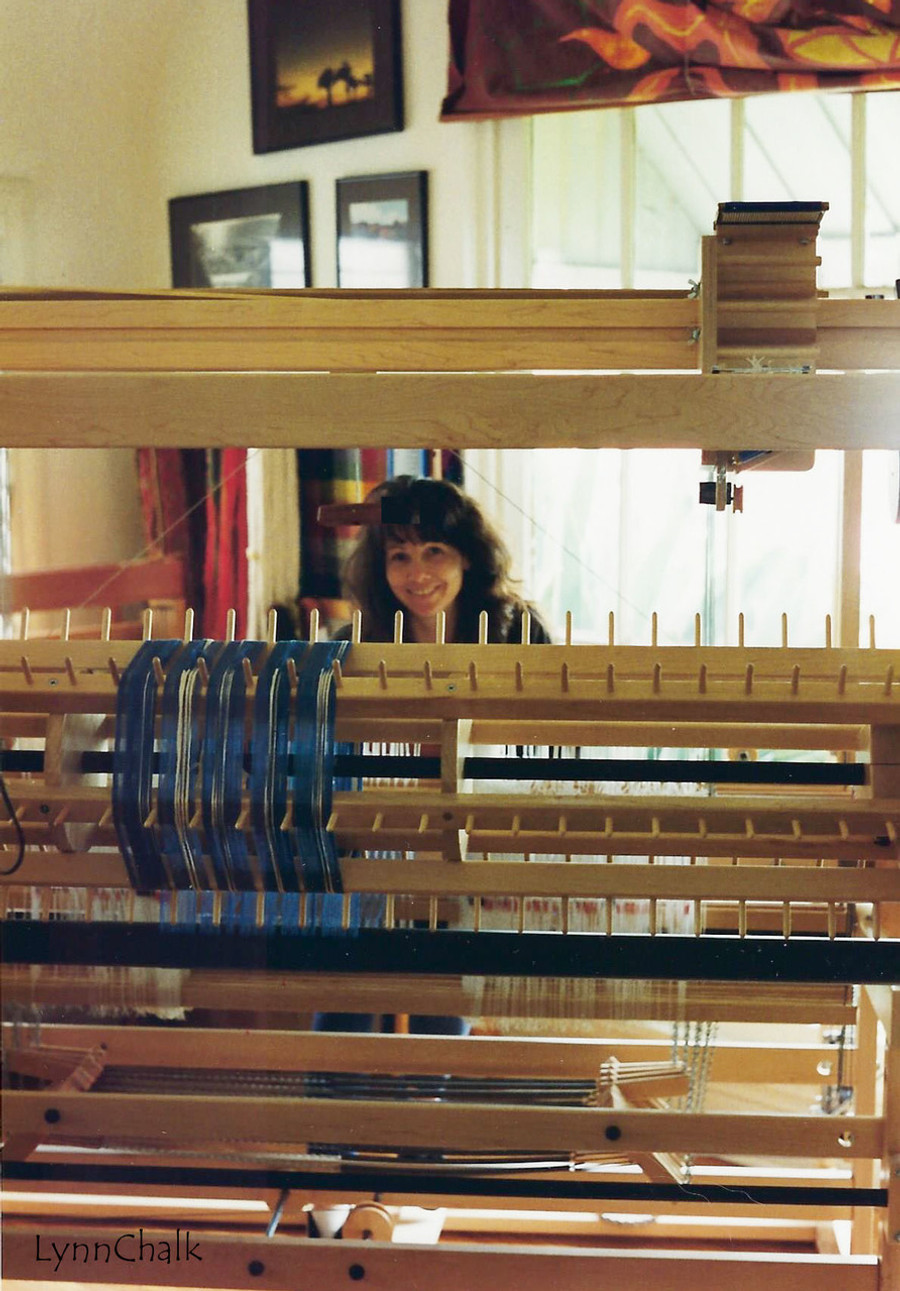 Weaving at the Loom.