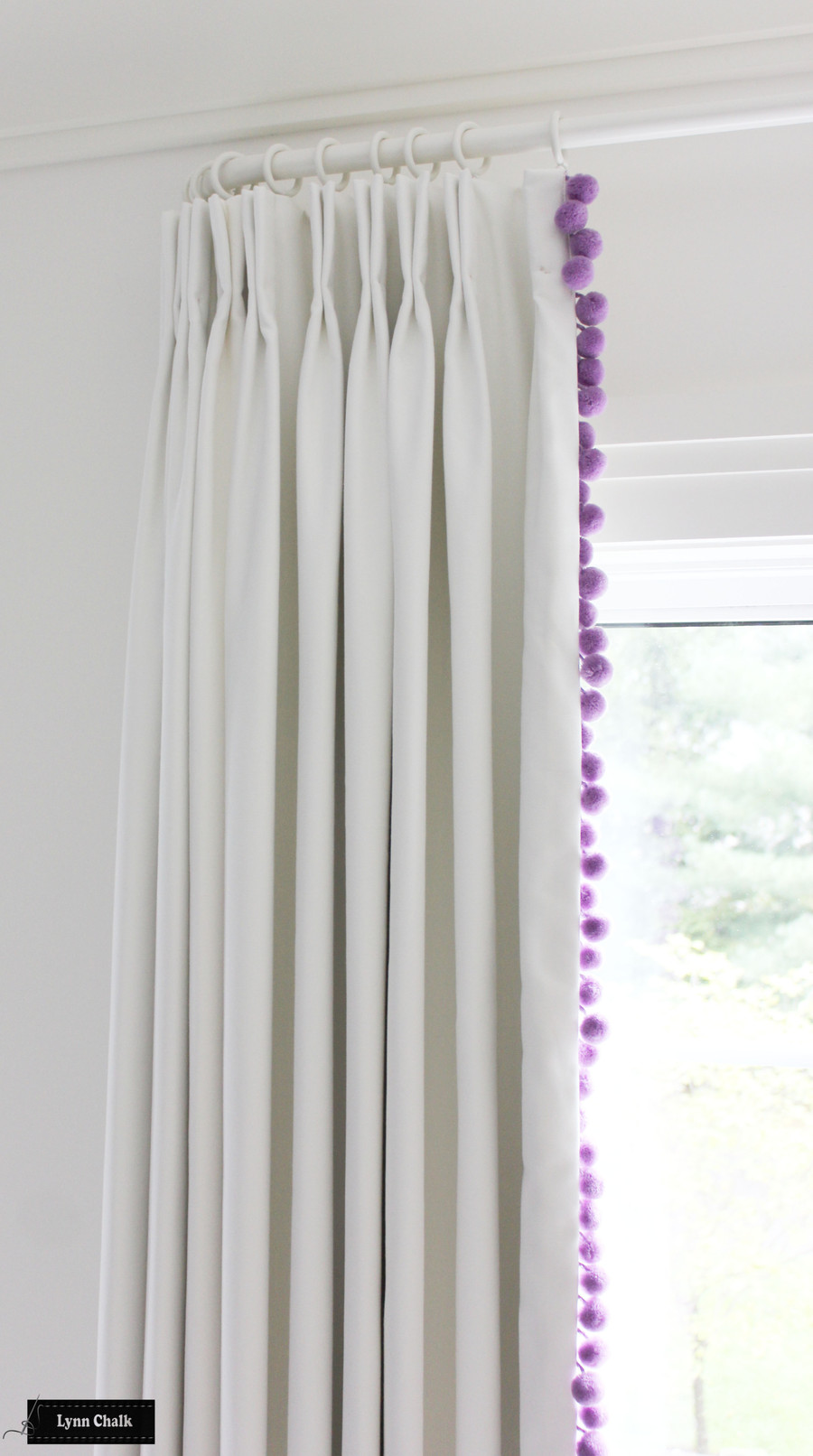 Girls Bedroom White Linen Drapes and Samuel and Sons Dolce Pom Pom Trim (shown in Sugarplum - comes in several colors)