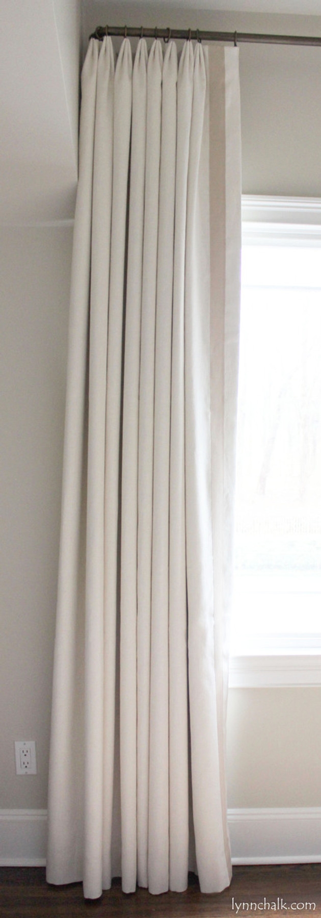 "Kravet Dublin Linen in Creme with 2"" Wide Samuel & Sons Grosgrain Ribbon Trim in Sand set in 1 1/2"" from edge.  Drapes are Double Width with Euro Pleat."