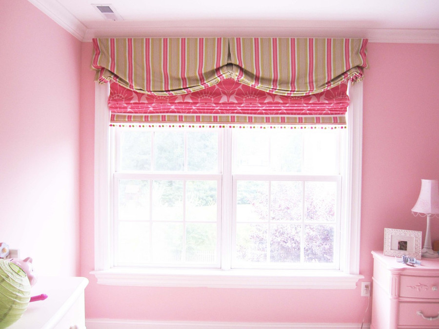 My client wanted a valance and roman shade similar to the one she saw in the magazine that I had done.  This roman shade has a border that matches the valance and a pom pom trim that has pink, green and white in it.