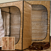 The portable Sauna Fix NIR 240 volt I plug Convertible Bundle assembled for the standing position (left) and sitting position (right) with travel storage bags.