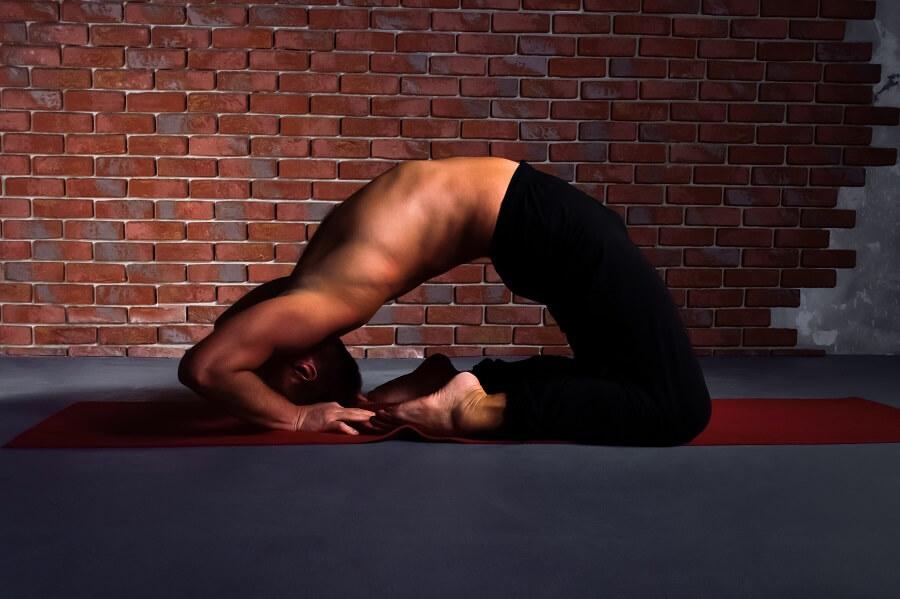 Man practices dove pose