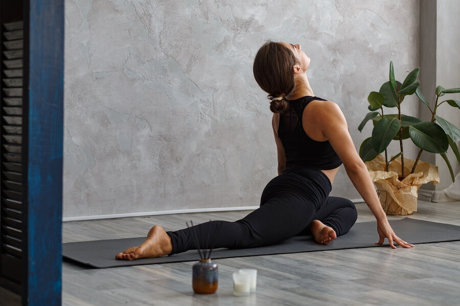 Woman practices pigeon pose