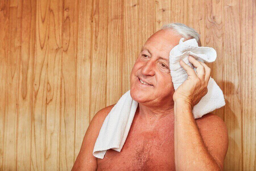 Man sweating in sauna