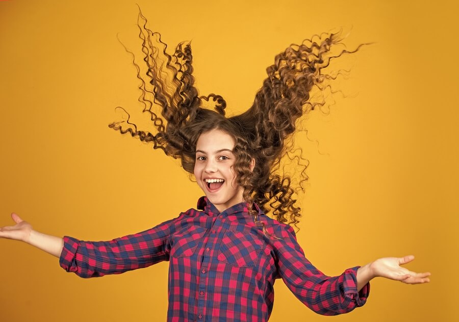 Young Girl Flipping Hair